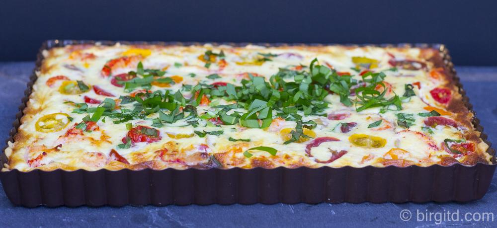 Bärlauch-Tomaten-Quiche – herzhafter Parmesan-Mürbeteig mit fruchtig-würziger Füllung